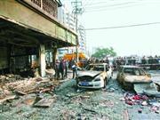 浙江温州煤气管道爆炸致近30家店铺受损(组图)